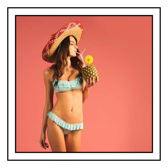Best Fabric for Swimsuits. Image showing girl in bikini holding pineapple